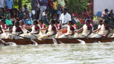 A Bunch Of Middle-Aged Women Row A Smaller Version Of The Kerala Snake Boat Thumbnail